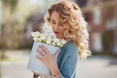 Beautiful woman with paper box of flowers Royalty Free Stock Photos