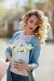 Beautiful woman with paper box of flowers Royalty Free Stock Photo
