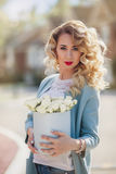 Beautiful woman with paper box of flowers Royalty Free Stock Image