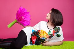 The beautiful woman with a paper flower. On pink Stock Photos