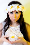 Beautiful woman with paper flower wreath Stock Photos