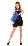 Beautiful woman with papper bag. Beautiful woman in short black dress with blue papper bag try to discover what is inside the bag Stock Images