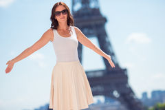 Beautiful woman in Paris background the Eiffel tower Stock Images