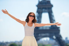 Beautiful woman in Paris background the Eiffel tower Stock Image