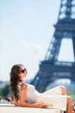 Beautiful woman in Paris background the Eiffel tower Stock Photography