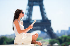 Beautiful woman in Paris background the Eiffel tower Stock Photo