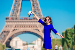 Beautiful woman in Paris background the Eiffel tower during summer vacation Stock Images