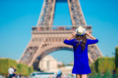 Beautiful woman in Paris background the Eiffel tower during summer vacation Stock Image