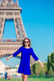 Beautiful woman in Paris background the Eiffel tower during summer vacation Stock Photos