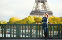 Beautiful woman in Paris on a fall day Royalty Free Stock Photo