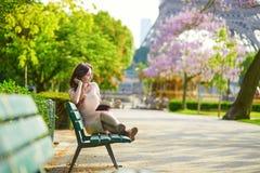 Beautiful woman in Paris, reading outdoors Stock Photos