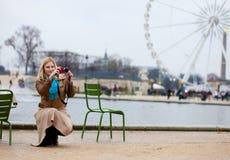 Beautiful woman in Paris using her camera Stock Photos