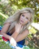 Beautiful woman at a park Stock Image