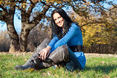 Beautiful woman in a park  in the autumn season Royalty Free Stock Photography