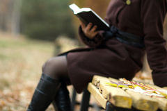 Beautiful woman in a park with a book Stock Photography