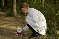 Beautiful woman in park with doggy Royalty Free Stock Photos