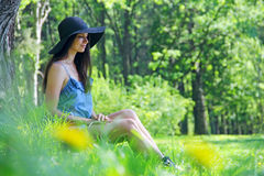 Beautiful woman in park Stock Photos