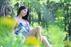 Beautiful woman in park Stock Images