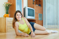 Beautiful woman on parquet Stock Image