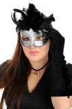 Beautiful woman in party carnival mask . Beautiful brunette woman in black dress in party carnival mask . isolated on white background Stock Image