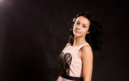 Beautiful woman in a party dress Stock Photo