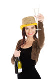 Beautiful woman in party dress making a toast with champagne. Beautiful woman in party dress, golden hat, brown bolero jacket is making a toast with champagne Stock Image