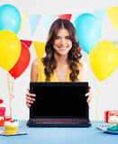 Beautiful woman at a party with laptopt Royalty Free Stock Photo