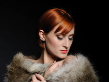 Beautiful woman with party make-up and fur Stock Images