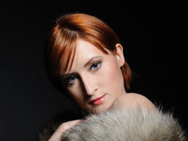 Beautiful woman with party make-up and fur Royalty Free Stock Photos