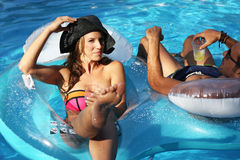 Beautiful woman during a party in a swimming pool Stock Photo