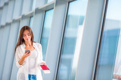 Beautiful woman with passports and boarding passes in airport Royalty Free Stock Photo