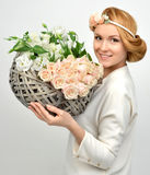 Beautiful woman with pastel color bouquet of wild white roses fl Royalty Free Stock Images