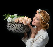 Beautiful woman with pastel color bouquet of wild white roses fl Royalty Free Stock Image
