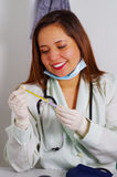 Beautiful woman patient having dental treatment at dentist`s office. Woman visiting her dentist.  Stock Photos