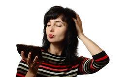 Beautiful woman pats her hair, Royalty Free Stock Photo