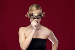 Beautiful woman with patterned masquerade mask Royalty Free Stock Photos