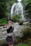 Beautiful woman pay respect to waterfall Stock Image