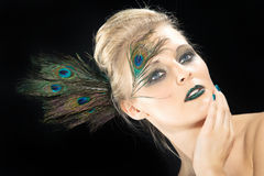 Beautiful woman with peacock feather Stock Photos