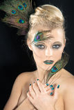 Beautiful  woman with peacock feather Stock Images