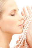 Beautiful woman with pearl beads royalty free stock photos