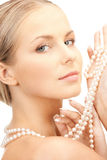 Beautiful woman with pearl beads Stock Photo