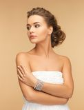 Beautiful woman with pearl earrings and bracelet Royalty Free Stock Images