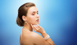 Beautiful woman with pearl earrings and bracelet Royalty Free Stock Image