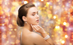 Beautiful woman with pearl earrings and bracelet Stock Photography
