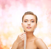Beautiful woman with pearl earrings and bracelet Royalty Free Stock Photos