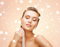 Beautiful woman with pearl earrings and necklace Royalty Free Stock Photo