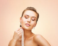 Beautiful woman with pearl earrings and necklace Royalty Free Stock Photography