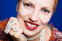 Beautiful woman with pearl necklace Stock Images