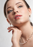 Beautiful woman with pearl necklace Royalty Free Stock Photos