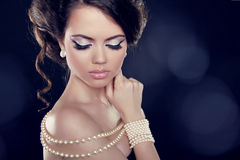 Beautiful woman with a pearl necklace on the bared shoulders Stock Photo